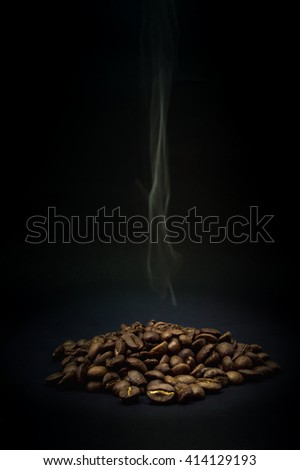 coffee beans with rising steam,dark style