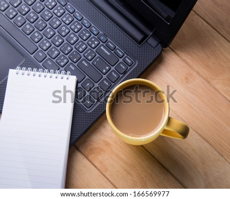 Coffee cup and notebook computers.