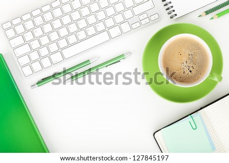 Coffee cup and office supplies. View from above. On white background