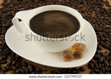 coffee cup and sugar with beans