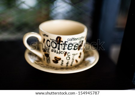 coffee cup on wood background, Dept of fileld