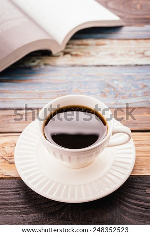 Coffee cup on wooden background - vintage effect pictures