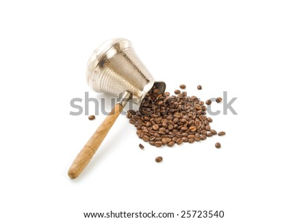coffee pot and coffee beans isolated on white