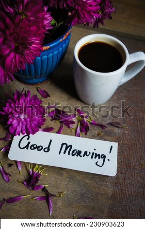 Coffee time, autumnal flowers in a vase, cup of coffee and Good morning note