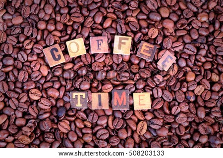 Coffee Time letters over coffee beans