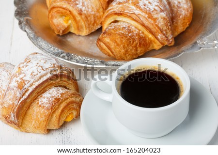 Coffee with fresh croissants