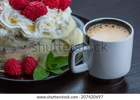 Coffee with raspberry cake and mint