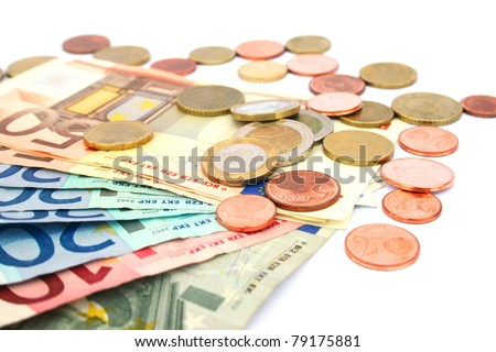 Coins and banknotes isolated on white background.