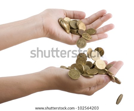 coins falling from hand to hand on a white background close-up