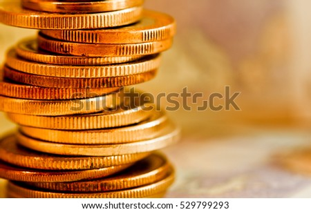 coins of different countries against euro banknote background
