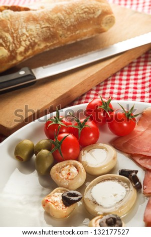 Cold appetizer, plate of assorted cold cuts traditional in mediterranean countries