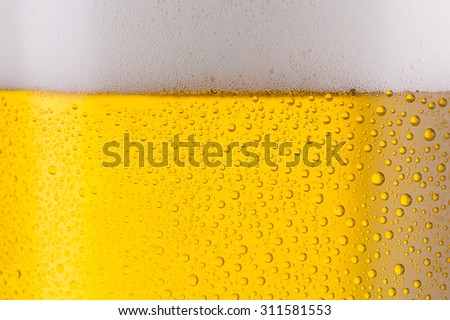 cold beer with drops of condensation background Texture