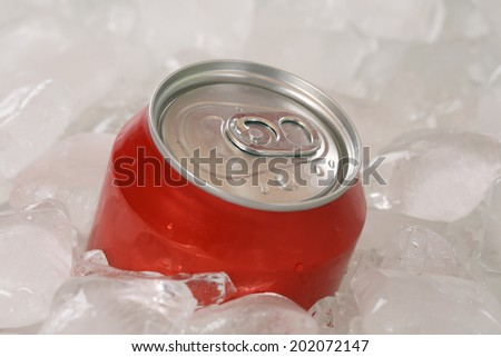 Cold cola or lemonade in a can on ice cubes