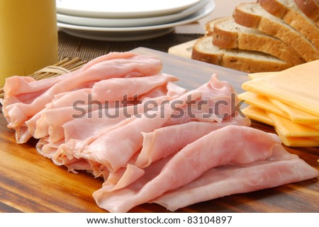 Cold cuts laid out on a sandwich buffet