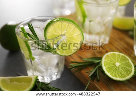 Cold fresh cocktail with lime on table