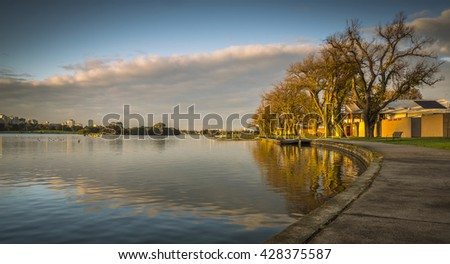 cold front calm sunrise city park lake reflections Melbourne autumn storm clouds
