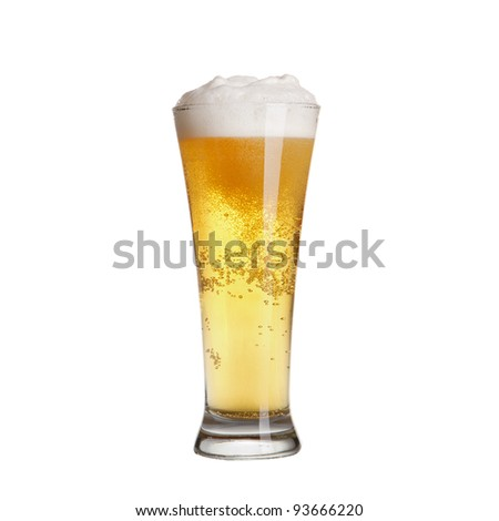 Cold lager beer in glass. Isolated on white background