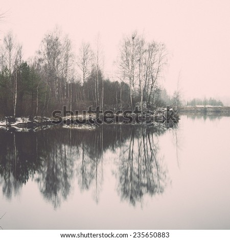 cold winter landscape with frozen river and icy water. vintage film effect retro