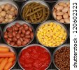 Collection of canned vegetables such as corn, peas, beans and tomatoes - stock photo