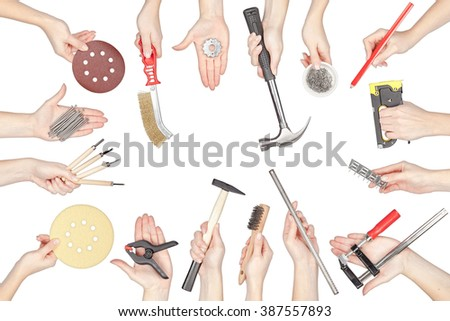 collection of carpenter tools in a hands isolated on white background