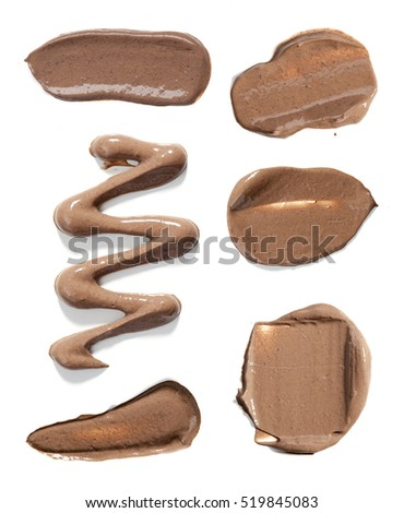 Collection of make up liquid foundation strokes on a white background