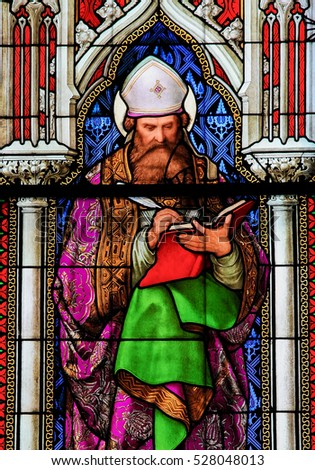COLOGNE, GERMANY - APRIL 21, 2010: Stained Glass in the Dom of Cologne, Germany, depicting Saint Augustine, one of the four Latin Church Fathers.