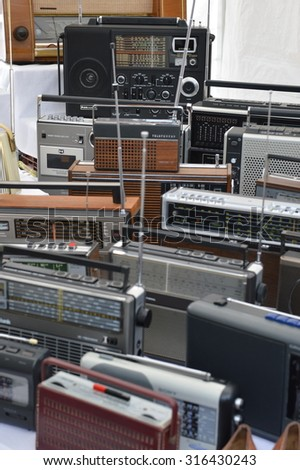 Cologne, Germany - September 6, 2015 - Old radio devices on garage market as a source for cheap shopping and collectors