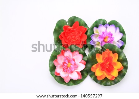 color artificial Lotus on white back ground. Hand made modern Thai art