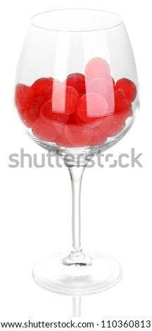 Color candies in glass isolated on white
