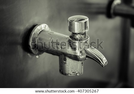 Color filter effect/ Public faucet and water drop/ Selective focus and Close up