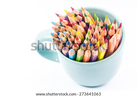 Color pencil in the cup on white background