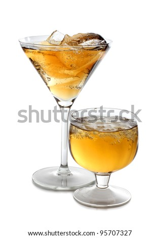 Color photograph of glasses of whiskey with ice