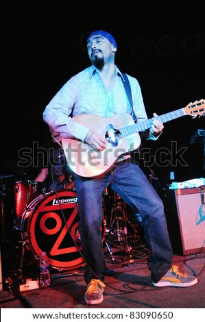COLORADO SPRINGS, CO. USA – MARCH 9: Guitarist Raul Pacheco of the Latin Hip-Hop Rock band Ozomatli performs on March 9, 2010 at the Black Sheep Theater in Colorado Springs, CO. USA