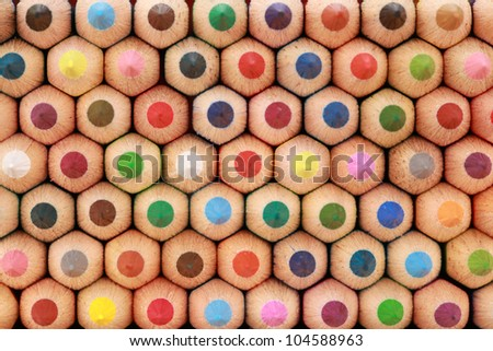 Colored crayons in a stack showing their tops.