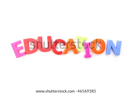 Colored fridge magnets spelling out 'education' on a white background