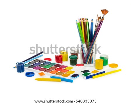 Colored pencils, felt tip pens, chalks, brushes and paint for painting isolated on white background. Tools of artist.