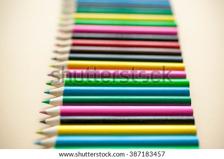 Colored pencils, isolated on the beige background