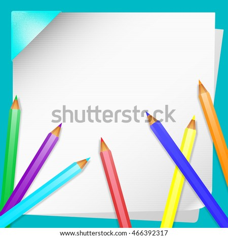 Colored pencils lying on a white sheet of paper
