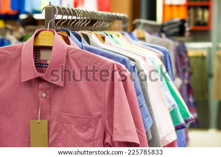 Colored shirts on hangers in a shop