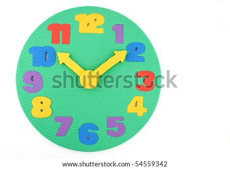 Colorful and round toy clock isolated in white background