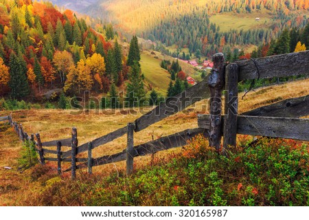 Colorful autumn landscape scene with fence in Transylvania mountain-Romania