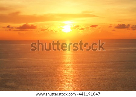 Colorful beautiful sunset on sea summer orange background