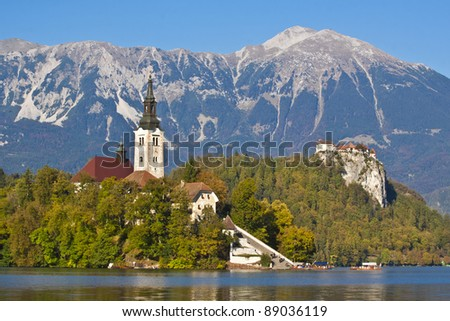 Colorful Bled in fall, with the rock top castle in the background. Slovenia