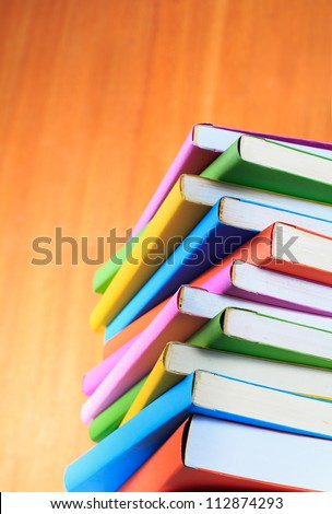 colorful books isolated on wooden background