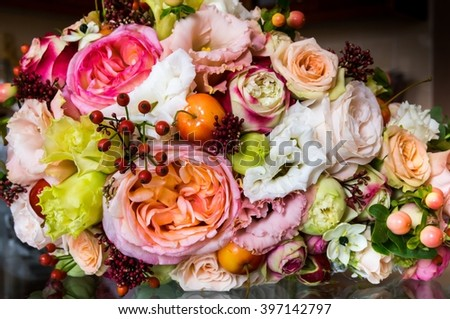 Colorful bouquet of the bride, fruits and flowers