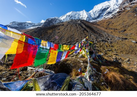Colorful buddhist flags at the rocks of Annapurna Sanctuary in Himalayas, Nepal