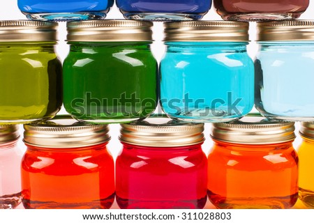 Colorful Canning Jars filled with brightly colored water stacked
