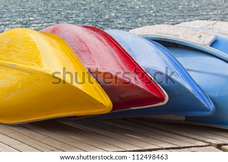 Colorful canoes await paddlers.