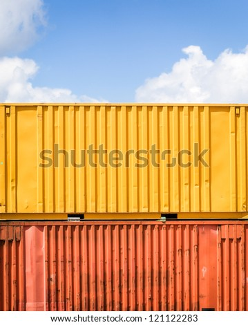 colorful cargo container in front of blue sky - with space for text