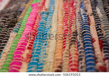 Colorful carpet texture. Background of andalusian carpet. Jarapa. Handmade carpet. Close up of beautiful hand made carpet